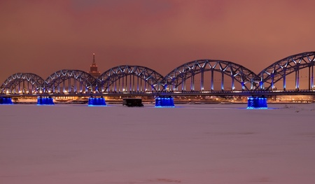 Riga railway bridge at night time in winter photo