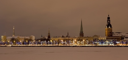 winter palace: View of the Old Riga at  night in the winter