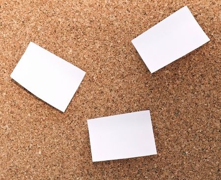 Cork board with three sticking papers Stock Photo - 8920292