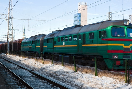 Diesel locomotive with cargo on winter station photo