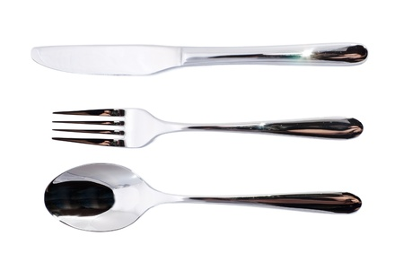 Spoon, fork and knife over white background photo
