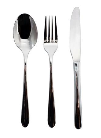 cubiertos de plata: Horquilla, cuchillo y cuchara sobre fondo blanco