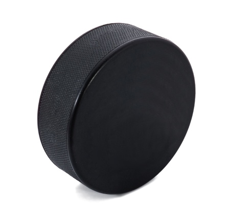 puck: Black puck over the white background Stock Photo