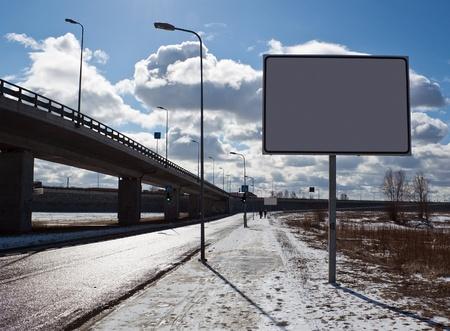 Blank billboard near the road photo