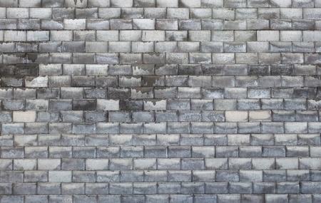 Pattern of wet brick stone wall photo