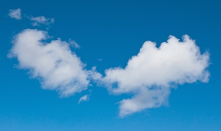 Two clouds on blue sky photo