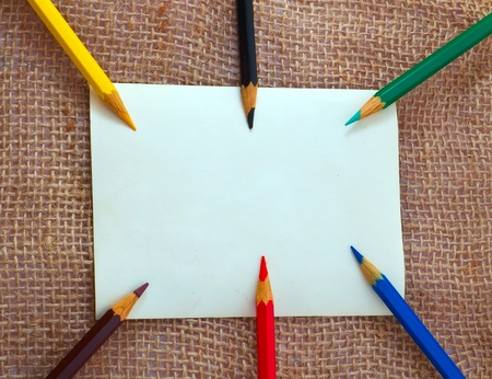 Blank card with different pencils photo