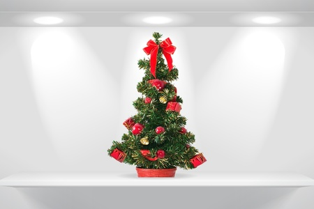 Christmas fir tree on the shelf photo