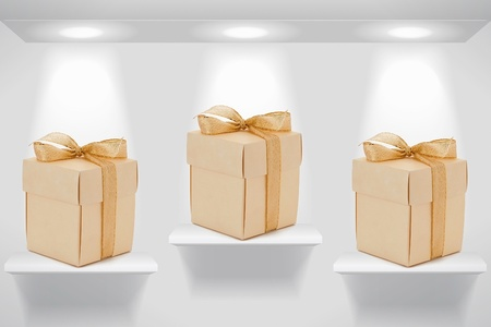 Three gift boxes on the wall shelves Stock Photo - 10601841