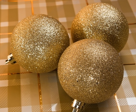Three golden holliday  decorative balls photo