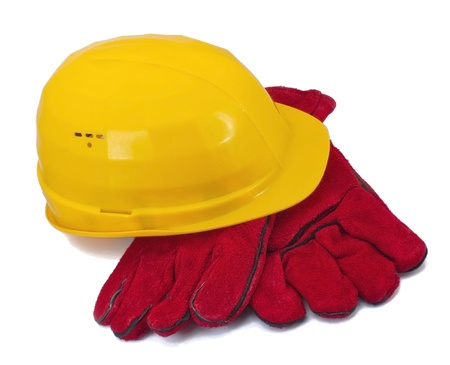 Yellow helmet and red gloves on white background photo