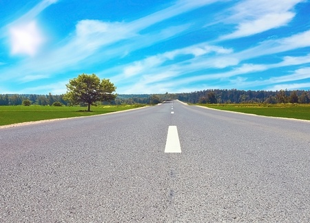 Road in field on sunny day  photo
