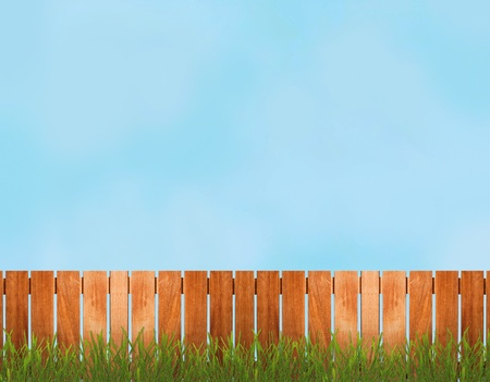 picket green: Fence with grass over the blue sky Stock Photo