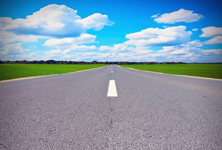 Road in the field on beautiful sunny day photo