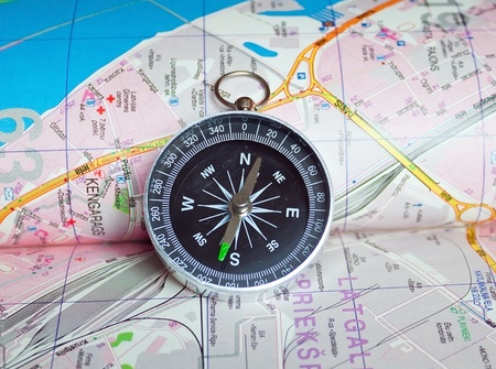 Compass on the map of city photo
