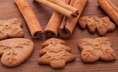 Gingerbread cookies and cinnamon stick photo