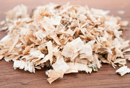 wood shavings: Birch and oak sawdust on wooden background