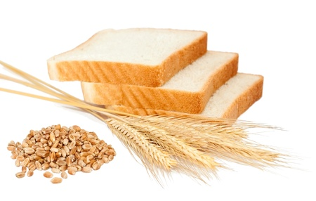 Wheat bread and grains and ears on white background photo