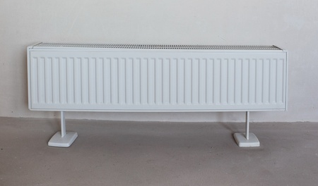 Radiator on the concrete wall background photo