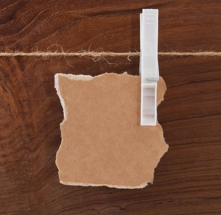 Card on the rope over wooden background photo