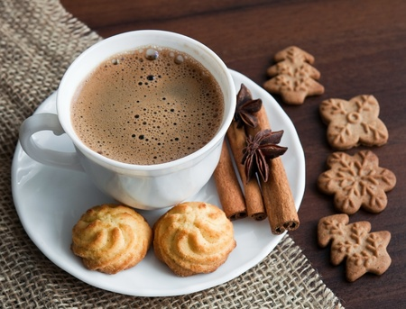 Coffee with cookies on rhe table photo