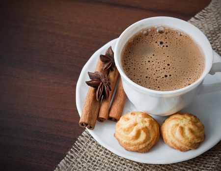 day break: Hot cup of  coffee  on sack with cookies