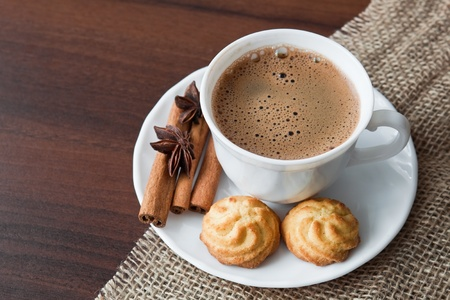 Hot cup of  coffee  on sack with cookies Stock Photo - 11753382
