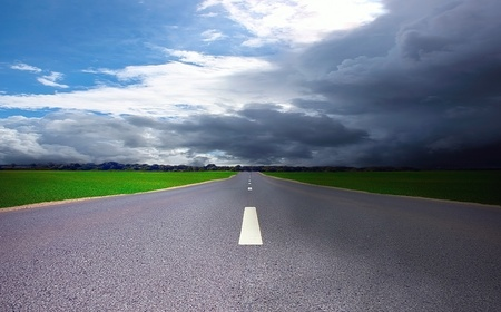Road in field in storm time Stock Photo - 11753418