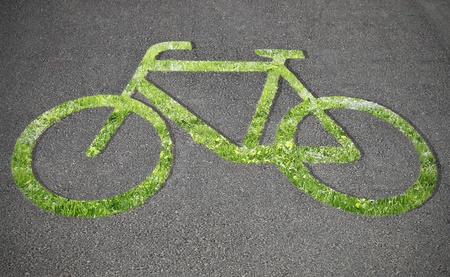 bicycle lane: Grass bicycle sign on the road