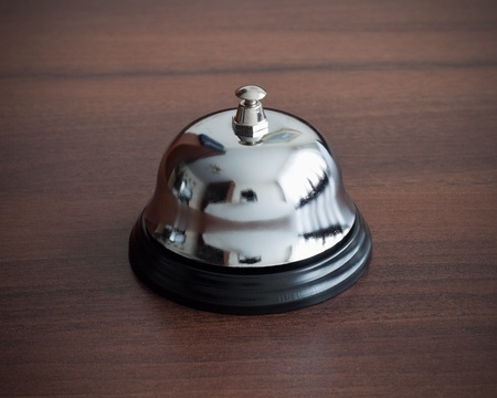 Service bell ring on wooden background photo