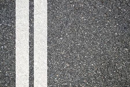 Patroon van asfalt structuur met twee lijnen