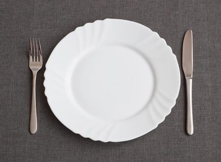 Set of utensil for dinner: plate, fork and knife Stock Photo - 12157420