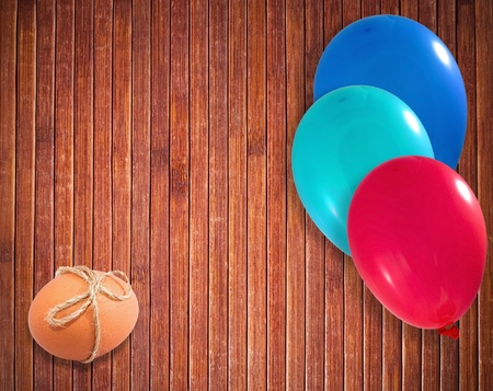 Easter egg withballoons on wooden background Stock Photo - 12157402