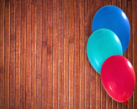 Balloons on the wooden background photo