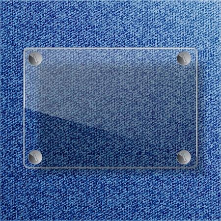 L'�tiquette de verre avec des vis sur le fond de jeans