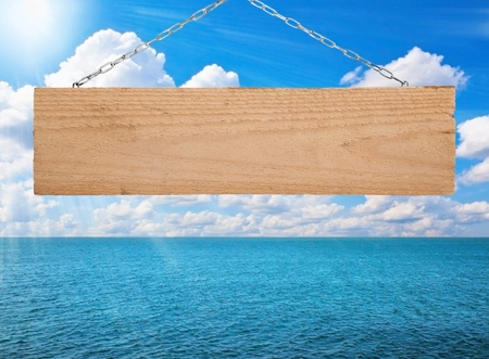 Signboard on the sunny ocean background photo