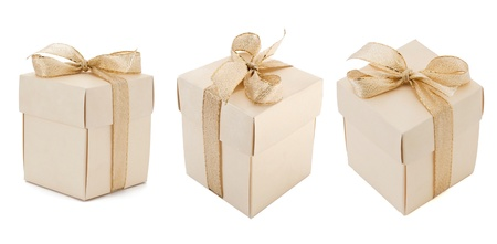 Gift boxes with golden ribbon on white background photo