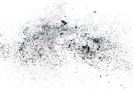 Charcoal dust pieces on white background Stock Photo