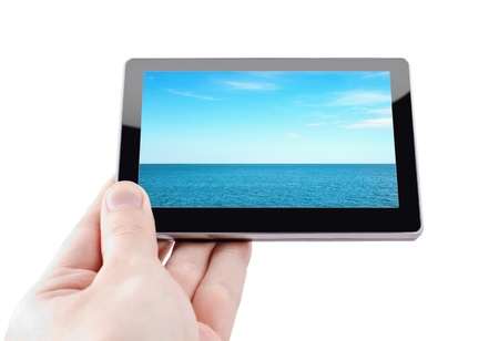 Modern tablet device in hand over white background photo