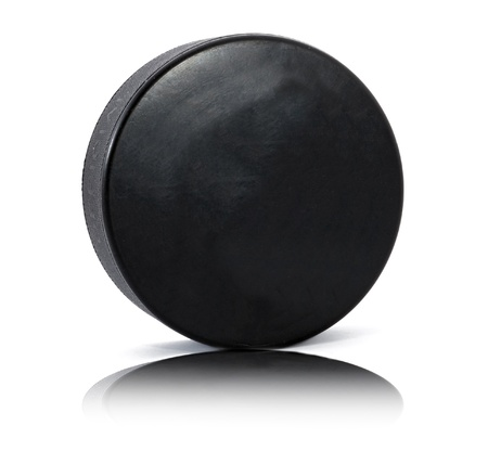Hockey puck on the white