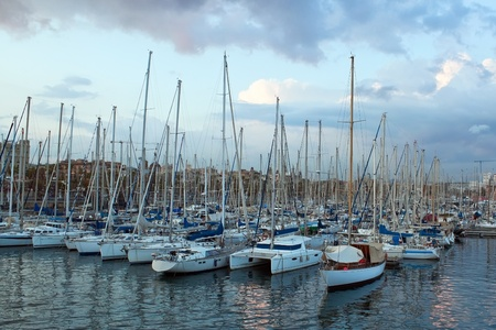 Barcelona yacht port in stormy evening photo