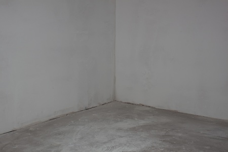 damaged roof: Wall concrete corner in  the empty room Stock Photo