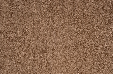 Pattern of the orange wall  plaster surface photo