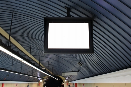Advertisement board in the underground hall photo