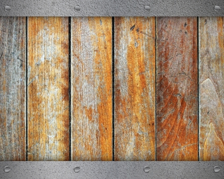 Metal plate with screws over the wooden background photo