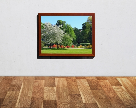 Wall with wooden floor with window to the park photo