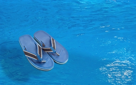 Slippers near the pool photo