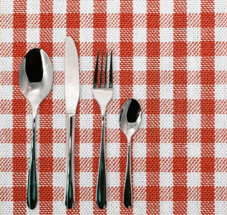 Lined white and blue dining cloth with silverware Stock Photo