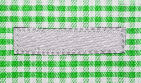 Green lined clothes with small label