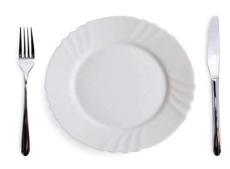 White dining plates and silverware on white background photo
